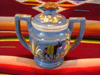 Mexican vintage pottery and ceramics, a lovely lidded jar with a blue background and exquisite artwork, Tlaquepaque, Jalisco, c. 1930. The jar is stamped on the bottom with the mark of the famous Arias shop in Tlaquepaque. Main photo of lidded jar.