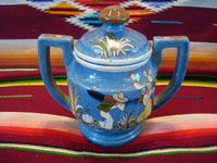 Mexican vintage pottery and ceramics, a lovely lidded jar with a blue background and exquisite artwork, Tlaquepaque, Jalisco, c. 1930. The jar is stamped on the bottom with the mark of the famous Arias shop in Tlaquepaque. Photo showing the second side of the jar.