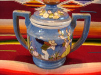 Mexican vintage pottery and ceramics, a lovely lidded jar with a blue background and exquisite artwork, Tlaquepaque, Jalisco, c. 1930. The jar is stamped on the bottom with the mark of the famous Arias shop in Tlaquepaque. Another view of one side of the jar.