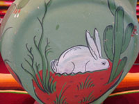 Mexican vintage pottery and ceramics, a beautiful flatware (opaco) water pitcher with a wonderful bunny and floral designs, Tonala, Jalisco, c. 1930's. Closeup photo of the bunny on one side of the pitcher.