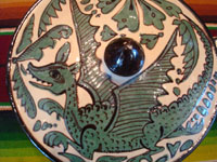 Mexican vintage pottery and ceramics, a fantasia-style lidded dish with fanciful dragon and fish, Tlaquepaque, Jalisco, c. 1930-40. Photo showing the dragon on the lid.