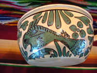 Mexican vintage pottery and ceramics, a fantasia-style lidded dish with fanciful dragon and fish, Tlaquepaque, Jalisco, c. 1930-40. Photo showing one of the fish decorating a side of the bowl.