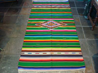 Mexican vintage sarapes and textiles, a beautiful Saltillo sarape with a green background and wonderful center diamond of silk, c. 1930's. Main photo of Saltillo sarape.