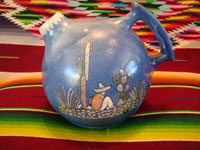 Mexican vintage pottery and ceramics, a stunning pottery pitcher with incredibly fine artwork, Tlaquepaque, Jalisco, c. 1920-30. The pitcher features a lovely soft-blue background, and the artwork features Mexican campesinos with cacti. Main photo of the Tlaquepaque pottery pitcher.