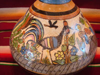 Mexican vintage pottery and ceramics, a water jar attributed to the great Balbino Lucano, Tlaquepaque, Jalisco, c. 1920-30's. The jar is done in the petatillo hatchwork style (with straw-like hatchwork in the background) for which Balbino Lucano is famous. Closeup photo of the wonderful artwork on one side of the Tlaquepaque pottery jar.
