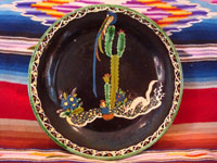 Mexican vintage pottery and ceramics, a wonderful black-ware plate with a very fine border and crisp artwork, Tlaquepaque or Tonala, Jalisco, c. 1920-30's. The artwork features a very playful squirrel and a wonderful tropical bird atop a graceful cactus, all set amidst plants and cacti. Main photo.
