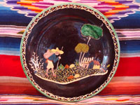 Mexican vintage pottery and ceramics, a wonderful black-ware plate with a very fine border and crisp artwork, Tlaquepaque or Tonala, Jalisco, c. 1920-30's. The artwork features a weary campesino with his trusty staff walking toward his lovely home. Main photo of the plate.