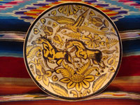 Mexican vintage pottery and ceramics, a stunning fantasia-ware plate with dashing horses, Tonala or Tlaquepaque, c. 1920-30's. Main photo of the Tonala pottery fantasia plate.