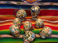 Mexican vintage pottery and ceramics, a fantastic tea-set (sugar, creamer, and cups) decorated with the starry night background and with wonderful human figures, Tonala or Tlaquepaque, Jalisco, c. 1920's. Main photo of the Tonala pottery tea set.