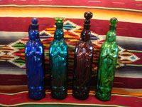 Mexican vintage devotional art, and Mexican vintage pottery and ceramics, hand-blown glass holy-water bottles in the shape of Our Lady of Guadalupe, c. 1940's. Three of the bottles have a rare metallic hue, and the fourth is a beautiful cobalt blue. Main photo.