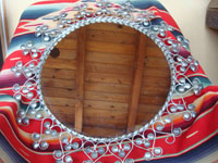 Mexican vintage tinwork art (tin art), a beautiful tinwork art mirror with exquisite tin bump-out's aroung the circular mirror, c. 1940's. Main photo of the mirror.