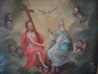 Mexican vintage fine art, and Mexican colonial devotional art, an exquisite oil painting of the Holy Trinity, surrounded by angels, and with Animas in Purgatory below, c. 18th or early 19th century.  Closeup photo of the Holy Trinity.