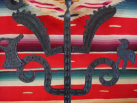 Mexican vintage folk art, and Mexican vintage devotional art, a wrought-iron cross with wonderful form and detailed stamping, San Cristobal de las Casas, Chiapas, c. 1950's. Closeup photo of the stamping on the wrought-iron cross from Chiapas.