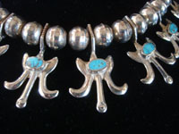 Native American Indian sterling silver jewelry, and Navajo silver jewelry, a beautiful Navajo silver necklace with beautiful turquoise, Arizona or New Mexico, c. 1950's. Closeup photo of a part of the Navajo silver jewelry necklace.