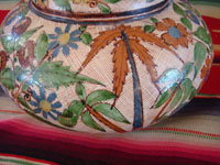Mexican vintage pottery and ceramics, a lovely water jar with drinking cup, with petatillo background and astounding artwork, Tonala or Tlaquepaque, Jalisco, c. 1930's.  Another closeup photo of a side of the jar.