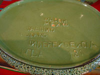 Vintage Mexican pottery and ceramics, a lovely lidded casserole with beautiful, hand-painted rural scenes on a pale green background, stamped on the bottom with the name of the famous pottery artist, Balbino Lucano, Tonala or Tlaquepaque, Jalisco, c. 1930-40's. Photo of the bottom of the casserole, showing the signature of Balbino Lucano.