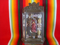 Mexican vintage devotional art, and Mexican vintage tinwork art, a lovely pottery statue of Our Lady of Guadalupe in a finely shaped and stamped tinwork-art nicho, c. 1950's. Main photo of the nicho.