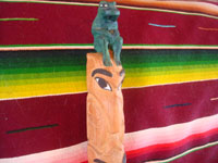 Native American Indian vintage woodcarvings and totem poles, a beautiful Kwakiutl carved totem pole, the Pacific Northwest, British Columbia, c. 1950.  Closeup photo of the top part of the pole, showing the green frog at the top.