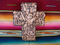 Mexican vintage devotional art, and Mexican vintage folk art, a beautiful wooden cross filled on three sides with silver milagros, c. 1950's. Main photo of the cross.