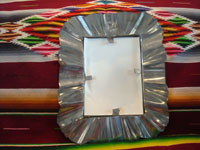 Mexican vintage tinwork art, a lovely tinwork-art mirror with a lovely design, c. 1950's. Photo showing the back side of the mirror.