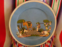 Mexican vintage pottery and ceramics, a lovely pottery plate with a soft-blue background and very fine artwork, attributed to the great Balbino Lucano, Tonala or San Pedro Tlaquepaque, Jalisco, c. 1930's. Main photo of the plate.