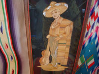 Mexican vintage straw-art (popote art or popotillo), a pair of straw-art scenes depicting a lovely China Poblana and her valiant Charro with his guitar, Mexico, c. 1930's.  Closeup of the image of the Charro.