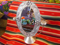 Mexican vintage tin art, a wonderfully stamped tin-work mirror, c. 1945. The mirror swivels up and down. It is extremely beautiful and very well-done! Main photo.