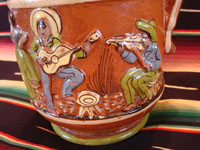 Mexican vintage pottery and ceramics, a wonderful pottery pulque pitcher from Tlaquepaque, Jalisco, c. 1930's. Closeup of the musicians on the pitcher.