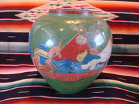 Mexican vintage pottery and ceramics, a beautiful burnished, green pottery olla with incredibly wonderful scenes, Tonala, Jalisco, c. 1930's. The scenes feature a campesino and his burro. Main photo of the entire olla or vase.