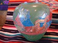 Mexican vintage pottery and ceramics, a beautiful burnished, green pottery olla with incredibly wonderful scenes, Tonala, Jalisco, c. 1930's. The scenes feature a campesino and his burro.