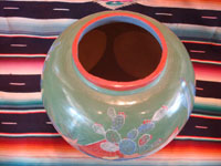 Mexican vintage pottery and ceramics, a beautiful burnished, green pottery olla with incredibly wonderful scenes, Tonala, Jalisco, c. 1930's. The scenes feature a campesino and his burro. Photo of the top of the olla, looking down on the mouth.