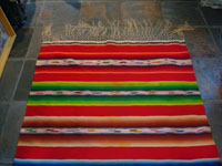 Mexican vintage textiles and Saltillo sarapes (serapes), a beautiful Saltillo sarape (serape, English spelling) with bright colors and a wonderful center diamond, c. 1930's. Another edge of the Saltillo serape (sarape) showing fringe.