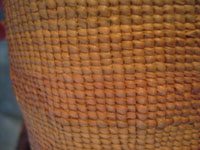Native American Indian antique baskets, a Northwest Coast twined, spruce-root basket, Haida, c. 1900. A closeup photo of the very fine and tight twining.