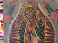 Mexican vintage tin-work art, and Mexican vintage devotional art, a lovely retablo painted on tin, depicting Our Lady of Guadalupe, Mexico, c. early 20th century.  Closeup photo of Our Lady's face.
