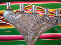 Mexican vintage tin-work art, a pair of tin candleholders with very fine stamping and bump-out work, Mexico, c. 1960's. Closeup photo of the stamping on one candleholder.
