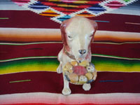 Mexican vintage folk art, and Mexican vintage pottery and ceramics, a wonderful piggy bank in the form of a delightful dog, by the famous Mexican folk artist Julian Acero, Tonala, Jalisco, c. 1930's. Photo of the front of the dog.