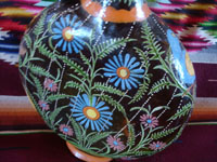 "Mexican vintage pottery and ceramics, a very beautiful and rare, ""starry-night"" blackware pitcher with incredibly fine artwork, Tlaquepaque or Tonala, Jalisco, c. 1920's. Closeup photo of the flowers on one side of the pitcher."