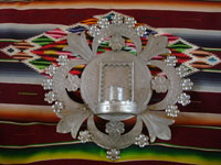 New Mexican vintage tinwork art, a very lovely tinwork sconce with a platform for a religious image and a candle, New Mexico, c. 1950's. Main photo of the tinwork art sconce.