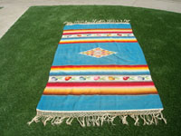 Mexican vintage textiles and Saltillo serapes (sarapes), a beautiful Mexican Saltillo serape (sarape), with a beautiful center medallion and wonderful rosetts in the decorative side bands. c. 1940's.  Main photo of the searpe.