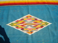 Mexican vintage textiles and Saltillo serapes (sarapes), a beautiful Mexican Saltillo serape (sarape), with a beautiful center medallion and wonderful rosetts in the decorative side bands. c. 1940's.  Photo of the center medallion woven of wool and silk, with wonderful colors.