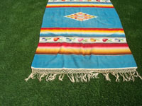 Mexican vintage textiles and Saltillo serapes (sarapes), a beautiful Mexican Saltillo serape (sarape), with a beautiful center medallion and wonderful rosetts in the decorative side bands. c. 1940's.  Another shot of one end of the Saltillo serape showing the fringe at one end.