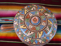 Mexican vintage pottery and ceramics, a very beautiful lidded pottery casserole with very fine and intricate artwork, Tonala or Tlaquepaque, Jalisco, c. 1950's.  Photo shot from above the lidded casserole, looking down at the top.