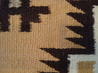 Native American Indian rugs and textiles, and Navajo rugs and textiles, a lovely Two-Gray-Hills Navajo rug with a fine weave and beautiful color scheme, New Mexico, c. 1950 or earlier.  Closeup photo showing the tightness of the weave of the Two-Gray-Hills Navajo rug.