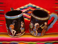 Mexican vintage pottery and ceramics, a wonderful pair of pottery mugs, with musicians, couples dancing, men drinking their tequila, all in relief and with beautiful animation and colors against a black background, Tonala or Tlaquepaque, Jalisco, c. 1930's.  Main photo of one side of the mugs.