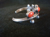 Native American Indian vintage silver jewelry, and Navajo vintage silver jewelry, a beautiful silver and coral bracelet, Navajo, c. 1930's. A side view of the Navajo silver jewelry bracelet with coral.