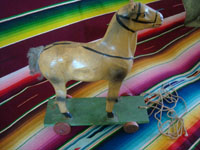Mexican vintage folk art, a wonderful paper mache horse on wheels and pulled with a string, c. 1940's. Main view of the horse.