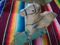 Mexican vintage folk art, a wonderful paper mache horse on wheels and pulled with a string, c. 1940's. A side view of the horse.