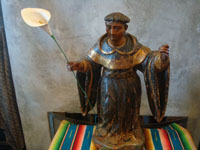 Mexican colonial devotional art, and Mexican colonial woodcarvings, a wooden statue of a saint, most likely St. Dominic, Mexico, c. 17th century. Main photo of the saint.