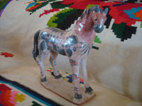 Mexican vintage folk art, and Mexican vintage pottery and ceramics, a lovely burnished pottery horse with beautiful hand-painted decorations, Tonala, c. 1950's. A view of the second side of the pottey horse.