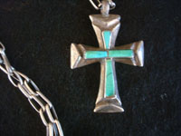 Native American Indian vintage sterling silver jewelry, and Navajo vintage silver jewelry, a beautiful sterling silver cross decorated with channel turqoise and with a wonderful hand-made sterling silver chain, Arizona or New Mexico, c. 1950's.  A closeup photo of the Navajo silver cross.